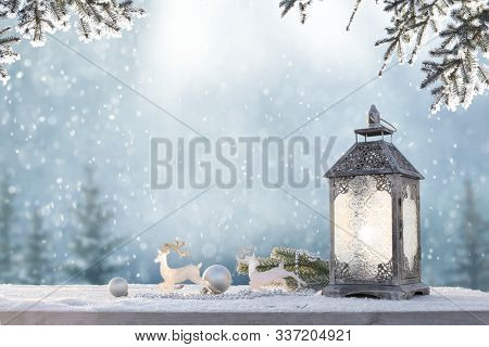 Holidays  background with  lantern, deer and balls