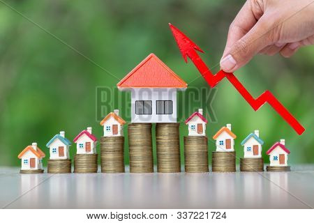 Arrow For The Beginning Of Investment. House Models. Home Model And Arrow Graph With Growing. Busine