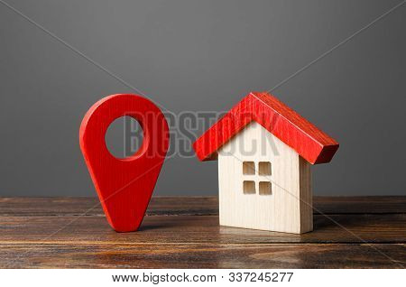 Figurine Wooden House And Red Location Pointer. Nice Neighborhood. Infrastructure And Utilities. Loc
