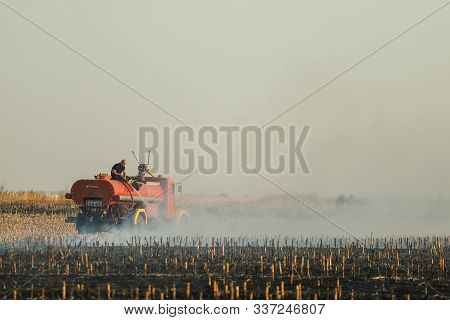 Pancevo, Serbia - October 24, 2019: Firefighters Extinguishing Fire On Burning Corn Field.