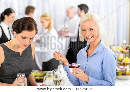 Business meeting buffet smiling woman eat dessert formal company event