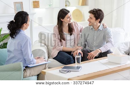 Successful, Effective Therapy Concept. Family Counselor And Happy Couple In Love After Effective The