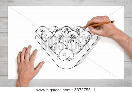 Male Hands Holding Pencil And Drawing Pool And Billiard Triangle On White Paper