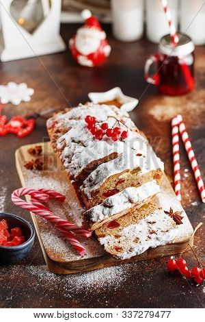 Stollen Is A Fruit Bread Of Nuts, Spices, And Dried Or Candied Fruit, Coated With Powdered Sugar.