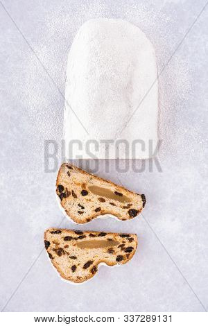 Christstollen, German Stollen Filled With Marzipan And Two Cut Slices Directly On Background With Ic
