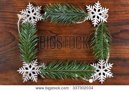 Frame From Christmas Decoration With Pine Tree And Snowflakes . Christmas And New Year Holidays Conc