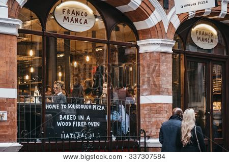 London, Uk - November 24, 2019: People Walking Past The Facade Of Franco Manca, Sourdough Pizza Rest