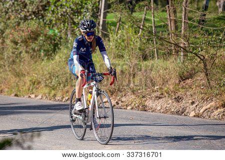 Villa De Leyva, Boyaca, Colombia - December 1, 2019:  Men And Women Of All Ages Ride Bicycles During