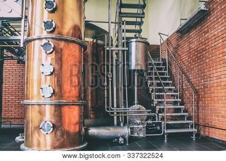 Industrial Equipment For Brandy Production. Copper Still Alembic Inside Distiller To Distill Grapes