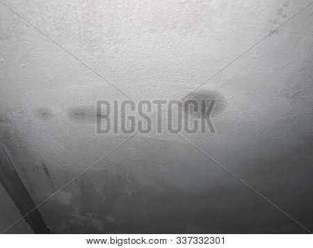 Dampness Moisture On Ceiling With Drops Of Water Infiltration