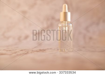 Essential Oil For Aromatherapy.organic Cosmetics With Extracts Of Herbs Rosemary On Marble Backgroun