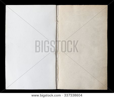 Antique Book Unfolded On The Endpaper, Showing Aged Textured Paper Inside, Isolated On Black Backgro