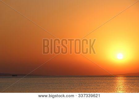 Dawn Above Sea. Beautiful Summer Dawn Above Ocean. Beautiful Blazing Sunset Landscape Above Red Sea