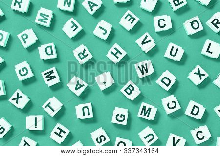 Letter Cubes Scattered On Monochromatic Green, Dictionary Or Dyslexia Reading Difficulty And Disorde