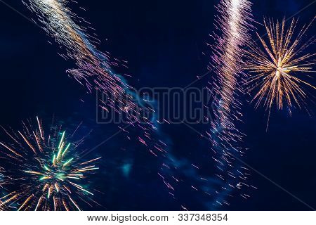 Inexpensive Fireworks, Over The City, Red And Blue. Celebration Conept, Motion Blur, For Any Purpose