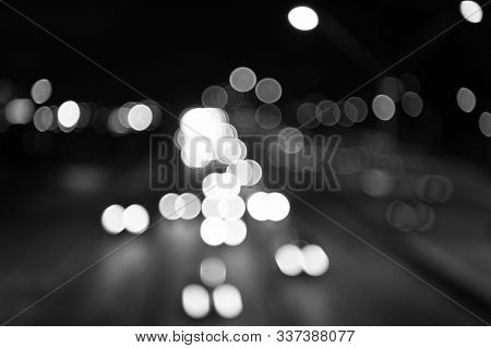 Night City Lights. Illumination And Lighting. White And Red Blurred Lamps. Watching Transport Moving