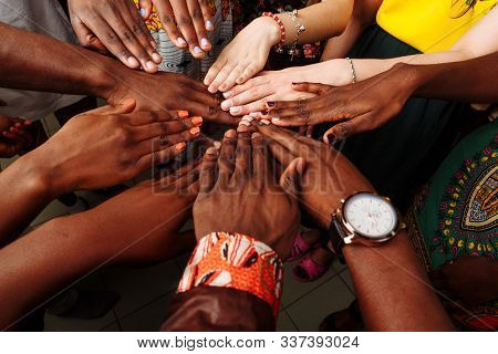 Hands Of Happy Group Of Multinational African, Latin American And European People Which Stay Togethe