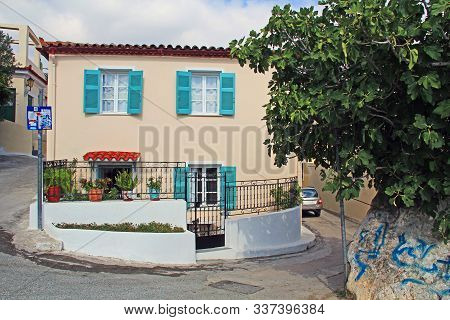 Athens, Attica, Greece - October 17, 2018:  The Front Of A Beautiful Typical Home With Aqua Shutters