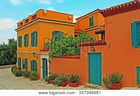 Athens, Attica, Greece - October 17, 2018:  The Front Of A Large Beautiful Typical Red Orange Home W
