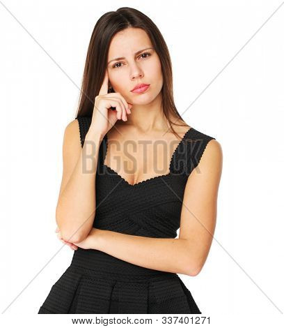 Pensive young brunette woman - isolated over a white background