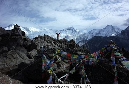 Himalayas, Nepal - June 03, 2019: Hiking in Nepal Himalayas, Tourist on top of Gorio Ri with view of Cho Oyu mountain