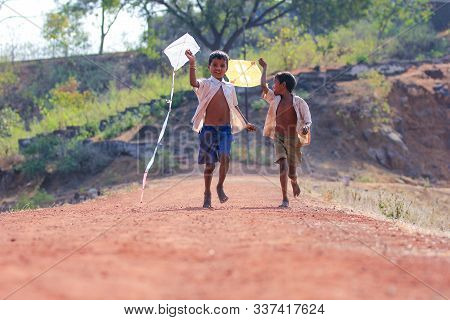 Indian / Asian Little Child Playing With Kite