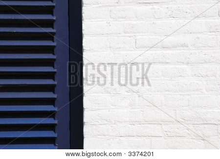 White Wall And  Blue Shutter