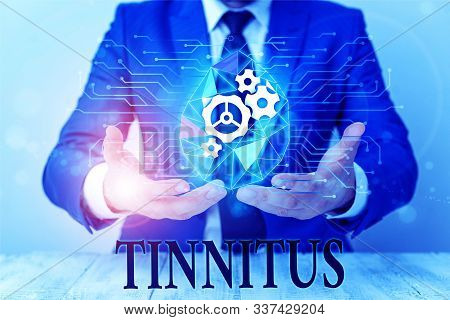 Writing note showing Tinnitus. Business photo showcasing A ringing or music and similar sensation of sound in ears Male human wear formal suit presenting using smart device. poster