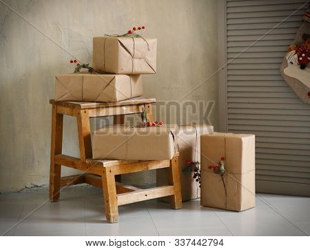 Christmas Presents In Boxes With Decoration Close Up Photo In Room Interior