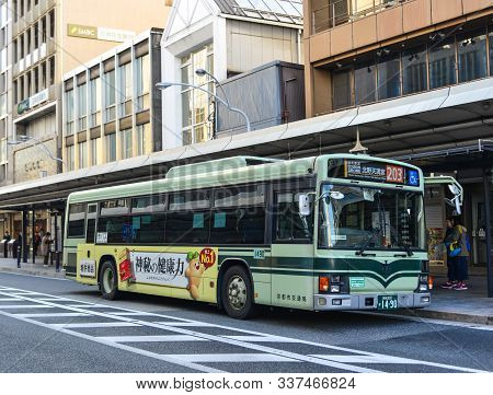 A Bus Running On Street In Kyoto, Japan