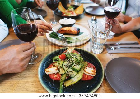 Good food and tasty red wine in a restaurant during lunch time