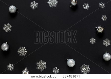 Christmas Balls And Decorative Snowflakes Isolated On Black Background. Concept Of Christmas And New