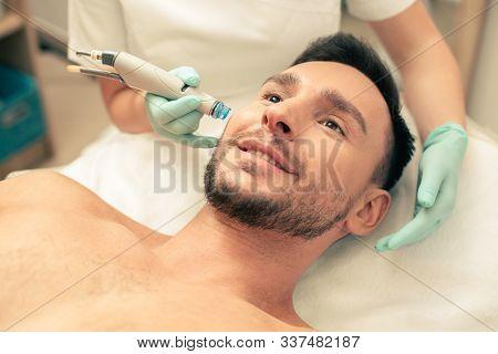 Face Of Man During The Skin Nourishment Procedure