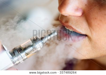 Smoking And Vaping May Be Unhealthy And Addictive And Pose Health Risk To Lung