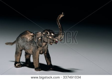 Golden Toy Elephant With Blood On Tusks On Grey Background, Hunting For Tusks Concept