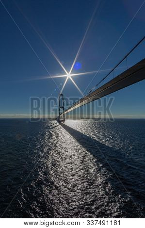 Oresund Bridge With Blue Sky, Blue Sea, Sun And Sun Flares