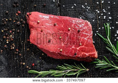 Raw Strip Loin Steak. Beef Meat. Black Background. Top View