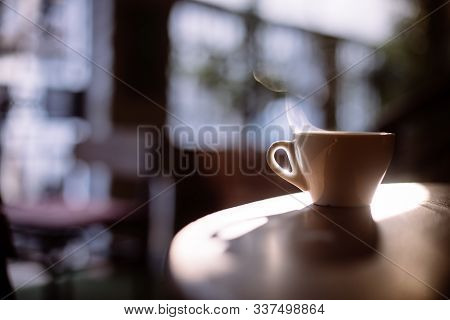 Image Of A Steamy Coffee Cup In The Sunlight, With Shallow Depth Of Field.