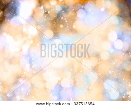 Abstract Glitter Defocused Background With Bokeh.Christmas and New Year holidays background.