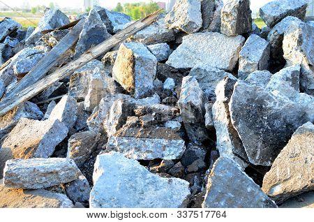 Recycling And Reuse Crushed Concrete Rubble, Asphalt, Building Material, Blocks. Broken Concrete Sla