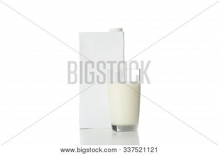 Blank Milk Box And Glass Of Milk Isolated On White Background