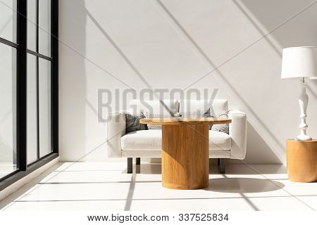 Bright Light Room With Sofa In Living Room Interior With Coffee Table And Lamp.