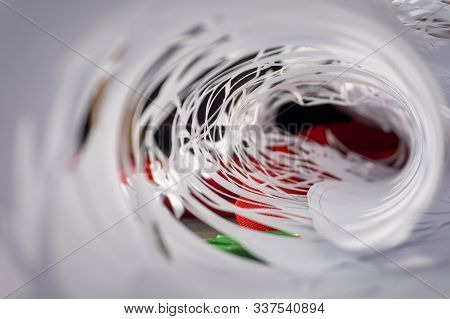 Rolled Intricate Homemade Christmas Decoration Cut From White Paper In A Receding Abstract Backgroun