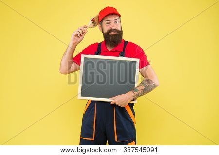 Quick Repair. Creative Decorator. Painting Works. Bearded Decorator Hold Chalkboard Advertisement Co