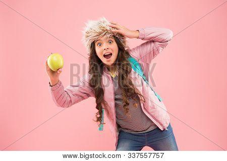 Eating Natural Food. Lunch Time. Stylish Schoolgirl. Girl Little Smiling Schoolgirl Hold Apple Fruit