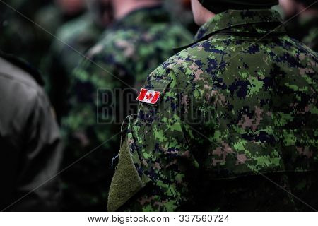 Details With The Uniform And Flag Of A Canadian Soldier Taking Part At The Romanian National Day Mil