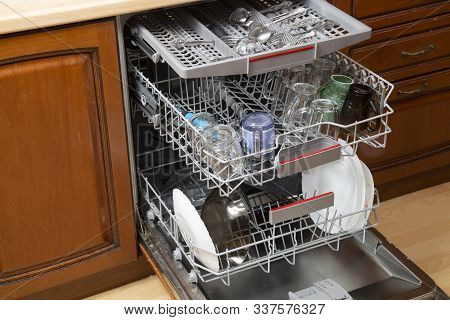 Dishwasher With Washed Dishes. Repair Of Dishwashers.
