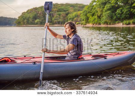 Summer Travel Kayaking. Man Paddling Transparent Canoe Kayak, Enjoying Recreational Sporting Activit