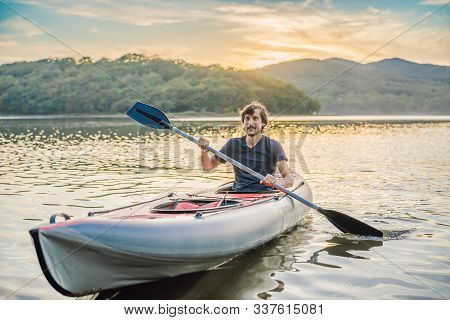Summer Travel Kayaking. Man Paddling Transparent Canoe Kayak, Enjoying Recreational Sporting Activit