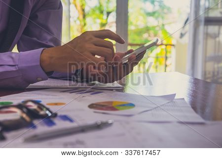Business Man In Office And Calculate Financial Plan Sales. Working On Desktop Computer Making Busine